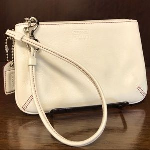 Beige coach wristlet with red stitching
